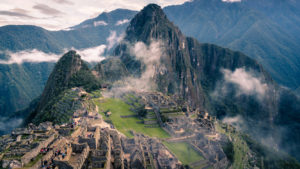 Overview image of peru - inca village with mountains in the clouds